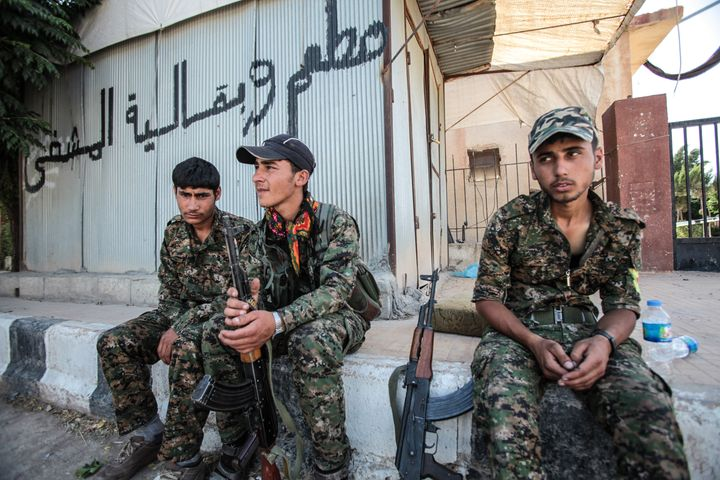 Kurdish People's Protection Units, or YPG, fighters rest in Tal Abyad, Syria on June 19, 2015.