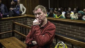 Danish man living in South Africa, Peter Frederiksen sits in the accused dock ahead of his bail application at the Bloemfontein Magistrate's court on November 4, 2015. Frederiksen was arrested in September 2015 after twenty-one severed vaginas were found stored in his home freezer. AFP PHOTO / GIANLUIGI GUERCIA        (Photo credit should read GIANLUIGI GUERCIA/AFP/Getty Images)