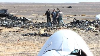 SUEZ, EGYPT - NOVEMBER 01: Russian officials inspect the crash site of Russian Airliner in Suez, Egypt on November 01, 2015. A Russian Airbus-321 airliner with 224 people aboard crashed in Egypt's Sinai Peninsula on yesterday. According to Egypts Civil Aviation Authority, the plane had been lost contact with air-traffic controllers shortly after taking off from the Egyptian Red Sea resort city of Sharm el-Sheikh en route to St Petersburg. (Photo by Mostafa El Shemy/Anadolu Agency/Getty Images)