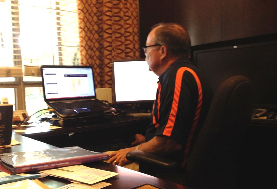 Don Hooton reviews data about teenage steroid use in his home office in McKinney, Texas.