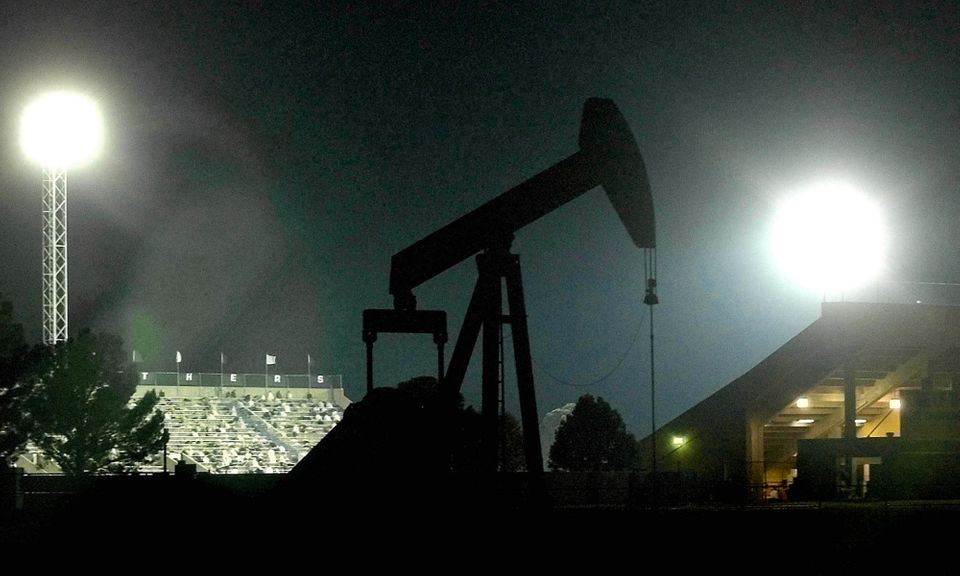 """<span class='image-component__caption' itemprop=""""caption"""">An oil pump outside the Permian High School football stadium in Odessa, Texas. The school was the subject of the book and movie """"Friday Night Lights,"""" which showcased the passion and craze around Texas high school football.</span>"""