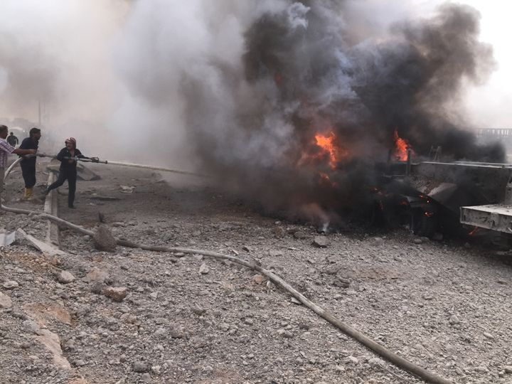 Firefighters extinguish the fire after a car bomb attack on YPG headquarters in Hasakah, Syria on September 15, 2015. At leas