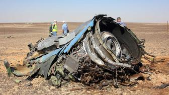 SUEZ, EGYPT - NOVEMBER 01: A plane part is seen as the Egyptian officials inspect the crash site of Russian Airliner in Suez, Egypt on November 01, 2015. A Russian Airbus-321 airliner with 224 people aboard crashed in Egypt's Sinai Peninsula on yesterday. According to Egypts Civil Aviation Authority, the plane had been lost contact with air-traffic controllers shortly after taking off from the Egyptian Red Sea resort city of Sharm el-Sheikh en route to St Petersburg. (Photo by Alaa El Kassas/Anadolu Agency/Getty Images)