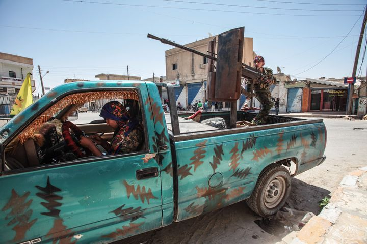 YPG fighters indowntown Tal Abyad, Syria on June 19, 2015.