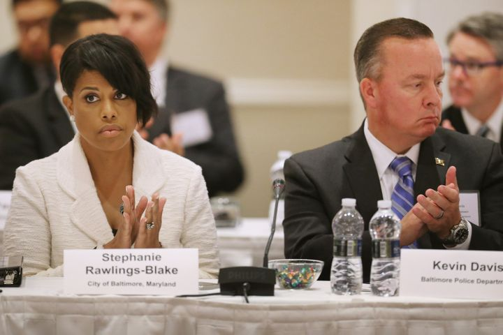 Baltimore Mayor Stephanie Rawlings-Blake (L), Baltimore Interim Police Commissioner Kevin Davis and other community and feder