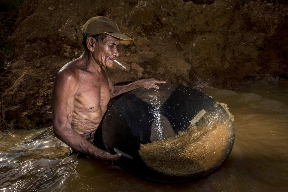 A traditional miner Masda (70), washes mud as he searches for diamonds in Cempaka village at Martapura, also known as the Cit