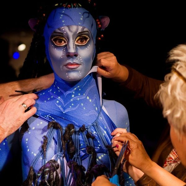 Singer Cumie Dunio while crew members transform her into character.