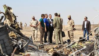 SUEZ, EGYPT - NOVEMBER 01: Russian Minister of Emergency Situations Vladimir Puchkov (3rd L) inspect the crash site of Russian Airliner in Suez, Egypt on November 01, 2015. A Russian Airbus-321 airliner with 224 people aboard crashed in Egypt's Sinai Peninsula on yesterday. According to Egypts Civil Aviation Authority, the plane had been lost contact with air-traffic controllers shortly after taking off from the Egyptian Red Sea resort city of Sharm el-Sheikh en route to St Petersburg. (Photo by Mostafa El Shemy/Anadolu Agency/Getty Images)