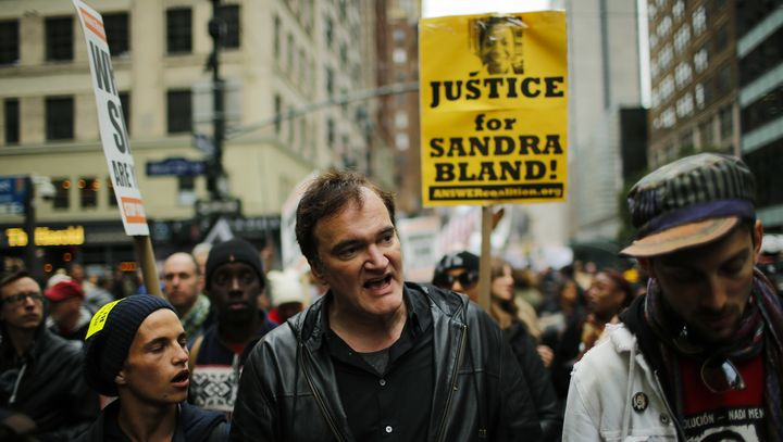 Quentin Tarantino (C) takes part in a march against police brutality called 'Rise up October' on October 24, 2015, in New Yor