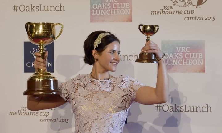 Australian jockey Michelle Payne poses with the winner's trophy during a Melbourne Cup Carnival press conference in Melbourne