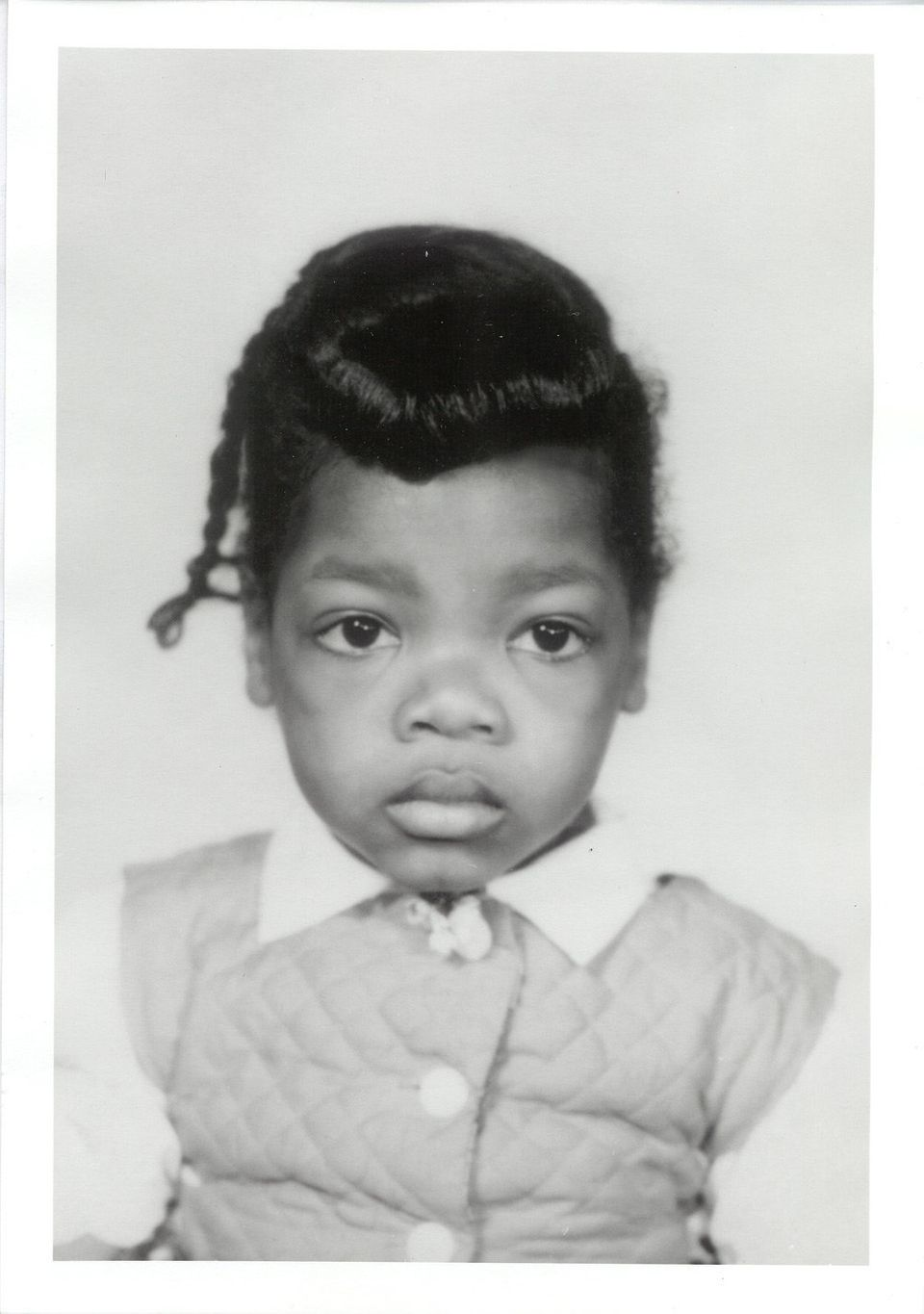 "Oprah says she's not the only one who had this hairstyle at 2 years old. ""Every black woman of a certain age will notice this"