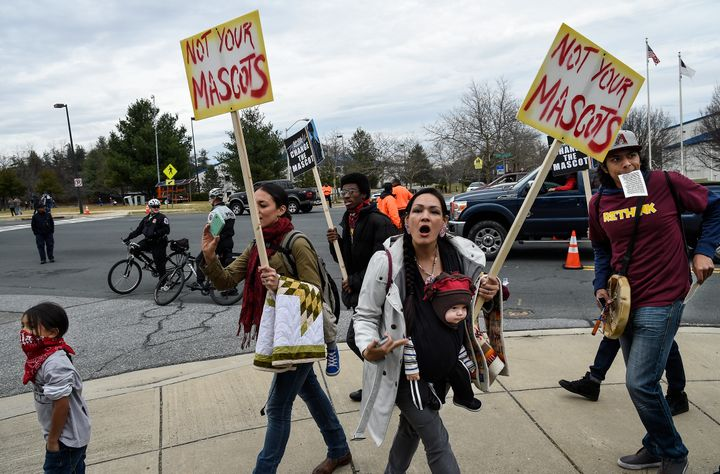 """""""We are people, not your mascot,"""" shouts Adrianne Plenty Holes ata protest of the name and logo of the Washington footb"""