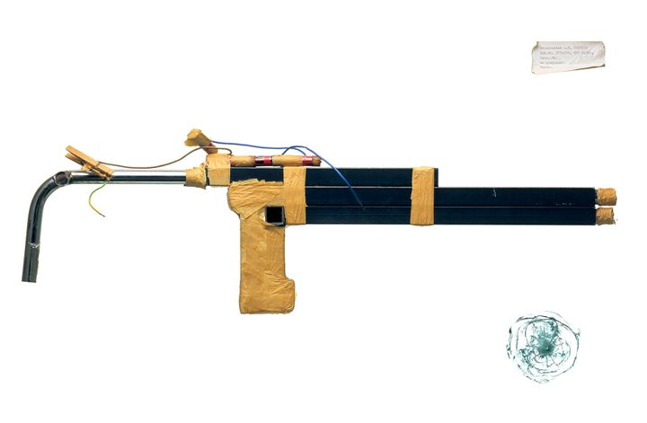 Shotgun made from iron bedposts; charge made of pieces of lead from curtain tape and match-heads, to be ignited by AA batteri