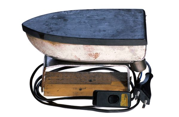 Hotplate fashioned from a flatiron which was pilfered from the prison laundry and fitted with a wooden stand. Confiscated in