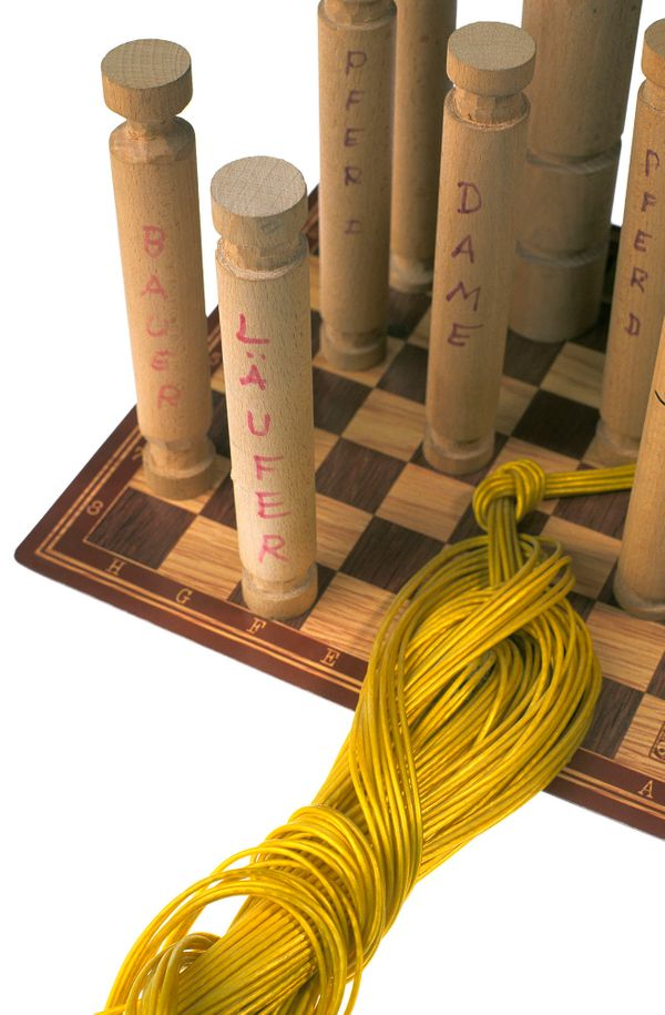 Rope ladder with wooden rungs disguised as chess pieces and clothesline; found and confiscated in an inmate's cell in W