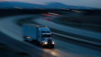 INDIO, CA - JANUARY 17:  A truck travels the Interstate 10 freeway on January 17, 2010 near of Indio, California. The San Andreas earthquake fault crosses all roadways and railways that connect the southern California metropolitan areas, as well as the busiest port complex in the nation, with the rest of the US. The January 12 magnitude 7.0 earthquake in Haiti suggests that the record-breaking earthquake could strike at any time on this section of the San Andreas Fault. Scientific consensus states a 99.7 percent chance that a magnitude 6.7 quake or larger will strike by 2037 on the southern portion of the 800-mile-long San Andreas Fault, east of Los Angeles. This section of the fault has had very little slippage for more than 300 years and has built up immense pressure that could touch off a significant earthquake at any time, according to seismologists. (Photo by David McNew/Getty Images)