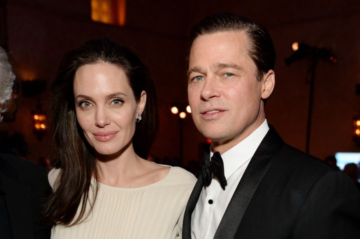 HOLLYWOOD, CA - NOVEMBER 05: Writer-director-producer-actress Angelina Jolie Pitt (L) and actor-producer Brad Pitt attend the after party for the opening night gala premiere of Universal Pictures' 'By the Sea' during AFI FEST 2015 presented by Audi at TCL Chinese 6 Theatres on November 5, 2015 in Hollywood, California. (Photo by Michael Kovac/Getty Images for AFI)
