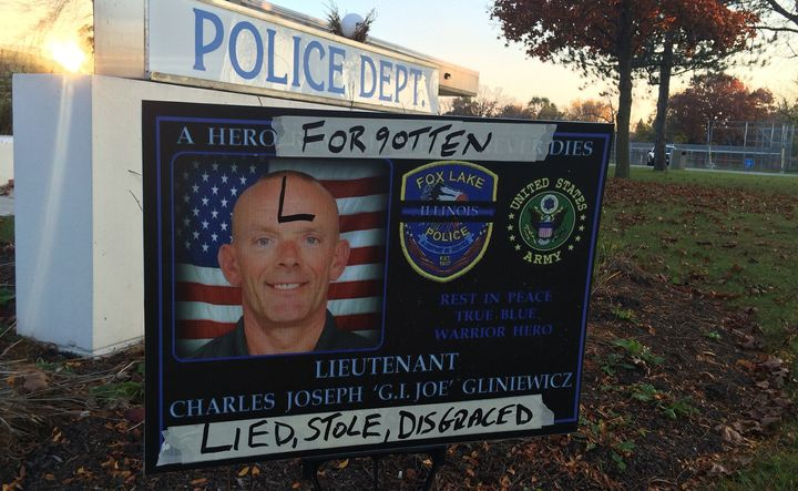 A sign honoring Lt. Joseph 'G.I. Joe' Gliniewicz is defaced outside Fox Lake, Ill. Officials say the late officer commit