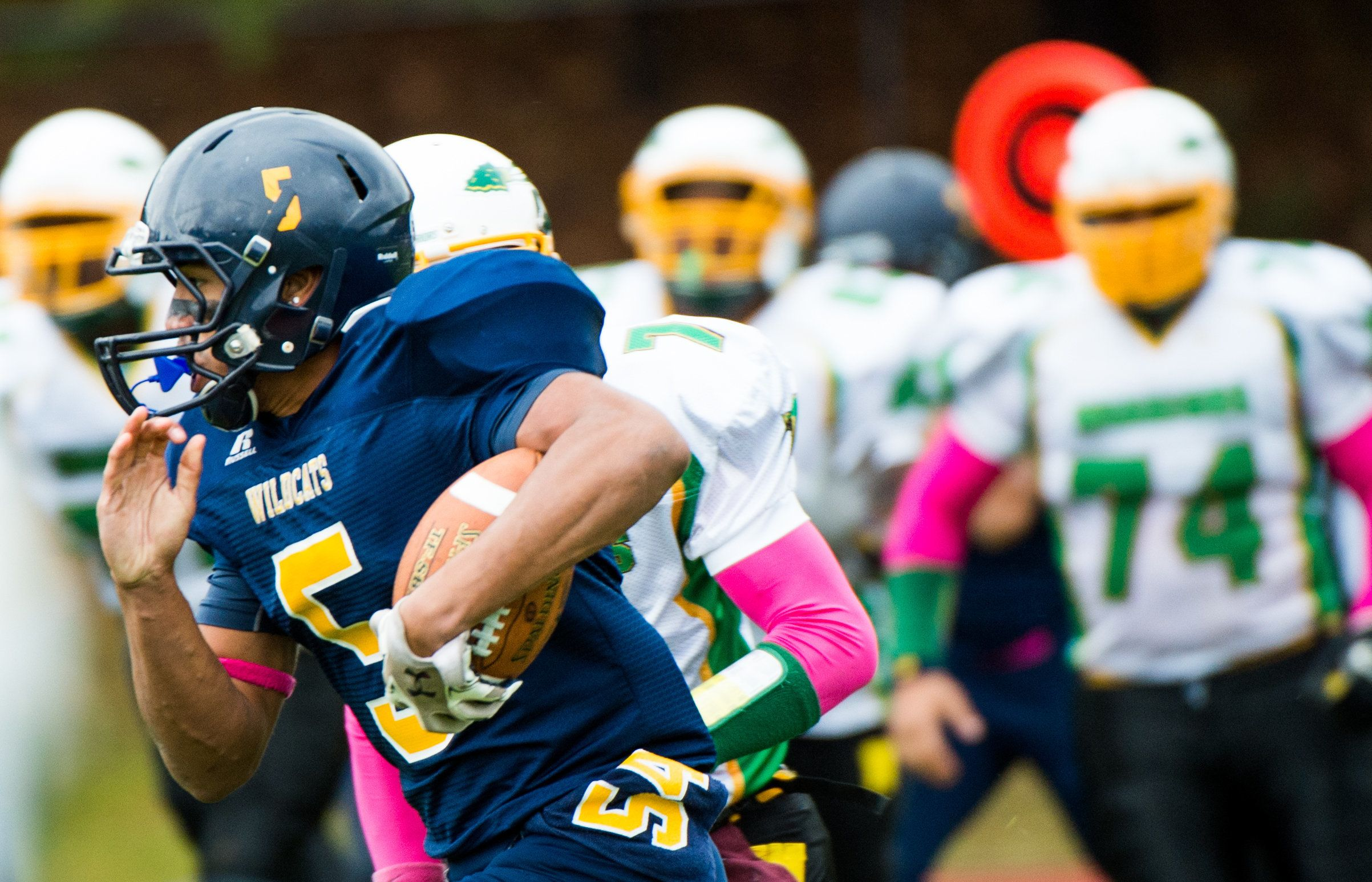 WADING RIVER, NY - OCTOBER 11: The Shoreham Wading River High School Football player Isreal Squires (5) runs against Wyandanch in their first game since their teammate Tom Cutinella died on the field the week before. (Photo by Andrew Theodorakis/Getty Images)
