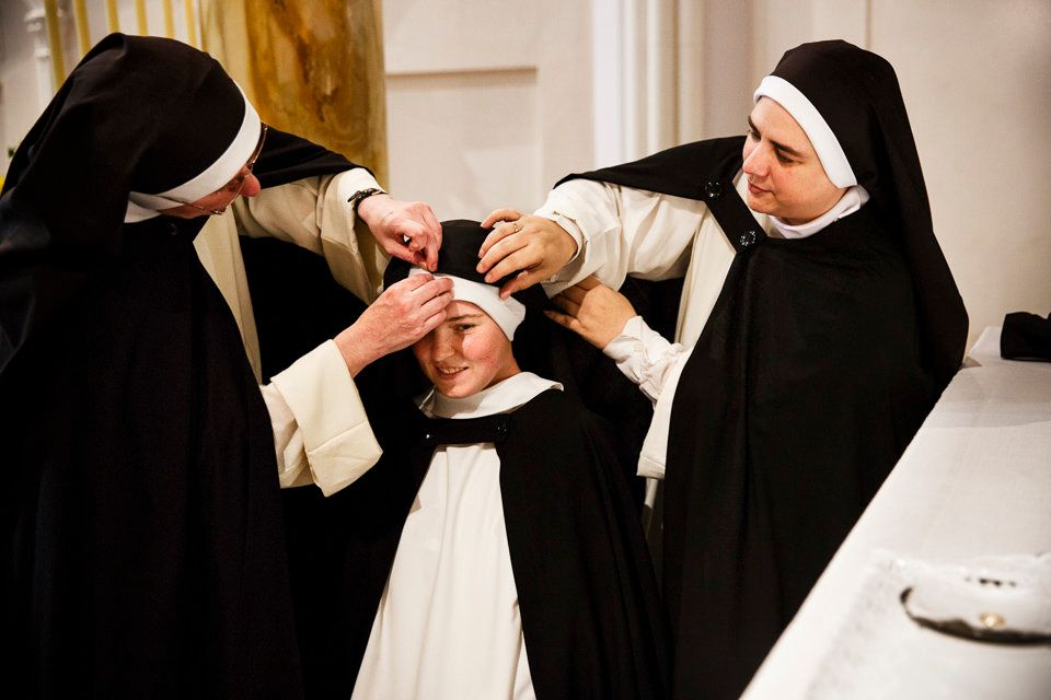 SUMMIT, NEW JERSEY - Sept. 6, 2014: As part of her Solemn Profession ceremony, 28-year-old Sister Maria Teresa'€™s black veil
