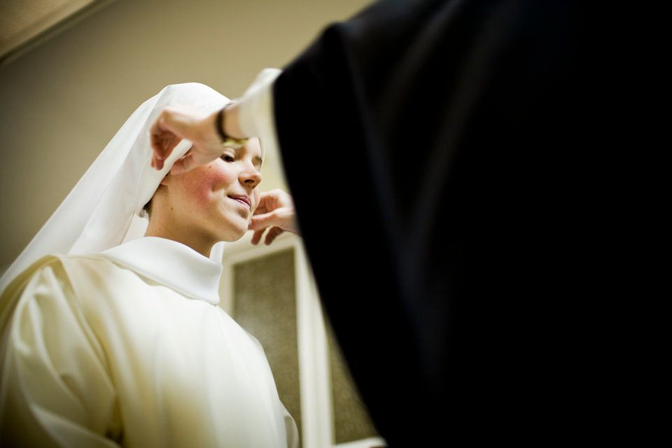SUMMIT, NEW JERSEY - Nov. 1, 2008: 22-year-old Sister Lauren receives her white veil (fitted by Sister Mary Martin, Prioress)