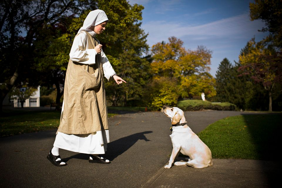 SUMMIT, NEW JERSEY - Nov.1, 2008: Sister Maria Teresa works on training Fred, the monastery dog, during her half-hour r