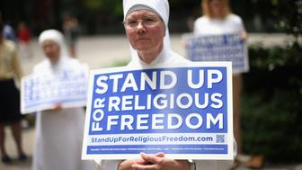 CHICAGO, IL - JUNE 30:  Sister Caroline attends a rally with other supporters of religious freedom to praise the Supreme Court's decision in the Hobby Lobby, contraception coverage requirement case on June 30, 2014 in Chicago, Illinois. Oklahoma-based Hobby Lobby, which operates a chain of arts-and-craft stores, challenged the provision and the high court ruled 5-4 that requiring family-owned corporations to pay for insurance coverage for contraception under the Affordable Care Act violated a federal law protecting religious freedom.    (Photo by Scott Olson/Getty Images)