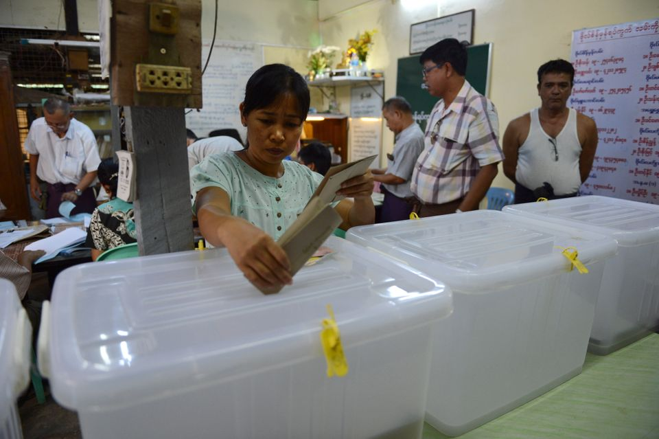 A voter casts a ballot during advance voting in Yangon, Myanmar on Nov. 6, 2015.