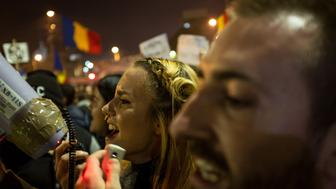 BUCHAREST, ROMANIA - NOVEMBER 05:  Protesters take part in a rally against the Romanian political class, November 5, 2015, in Bucharest, Romania. Tens of thousands have come in the streets to protest, following the deaths of over thirty people in a fire that broke out in a club in Bucharest last week. (Photo by Andrei Pungovschi/Anadolu Agency/Getty Images)