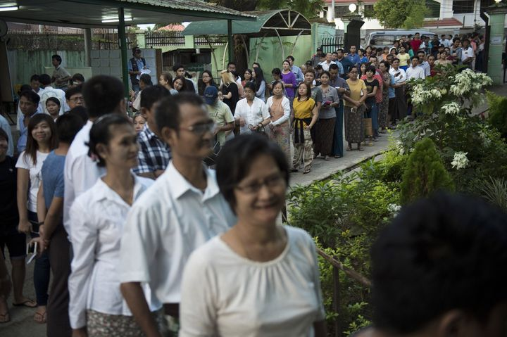 People queue to cast their vote at a polling station in Yangon on November 8, 2015.