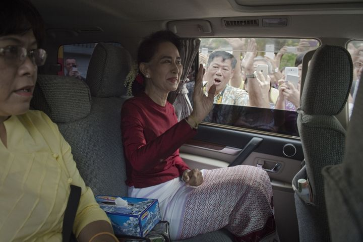 Myanmar opposition leader and head of the National League for Democracy (NLD) Aung San Suu Kyi leaves her house to cast her v