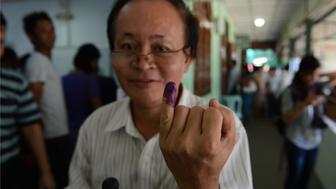 A Myanmar voter displays his inked finger after casting his ballot at a polling center in Yangon on November 8, 2015. Myanmar goes to the polls in an historic election that could thrust opposition leader Aung San Suu Kyi's pro-democracy party into power and pull the country away from the grip of the military.  AFP PHOTO / ROMEO GACAD        (Photo credit should read ROMEO GACAD/AFP/Getty Images)