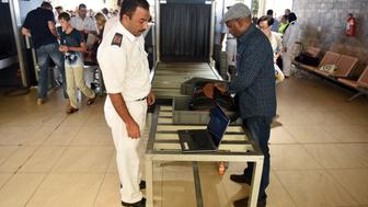 Egyptian airport security check passenger's luggage as they pass through security in Egypt's Red Sea resort of Sharm El-Sheikh on November 6, 2015. Britain moved to repatriate thousands of tourists from Egypt's Sharm el-Sheikh after warnings a 'terrorist bomb' may have brought down a Russian jet that took off from the resort, as several nervous airlines scrapped their flights. AFP PHOTO / MOHAMED EL-SHAHED        (Photo credit should read MOHAMED EL-SHAHED/AFP/Getty Images)