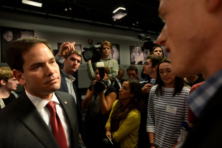 Republican presidential candidate Marco Rubio (R-Fla.) meets people following a round table discussion at Saint Anselm Colleg
