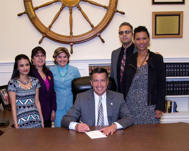 Gloria Allred, Lise-Lotte Lublin and Benjamin Lublin join Nevada Governor Brian Sandoval as he signs AB212 into law.