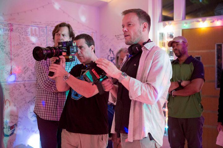 "Jason Moore, far right, directsa scene on the set of""Sisters."""