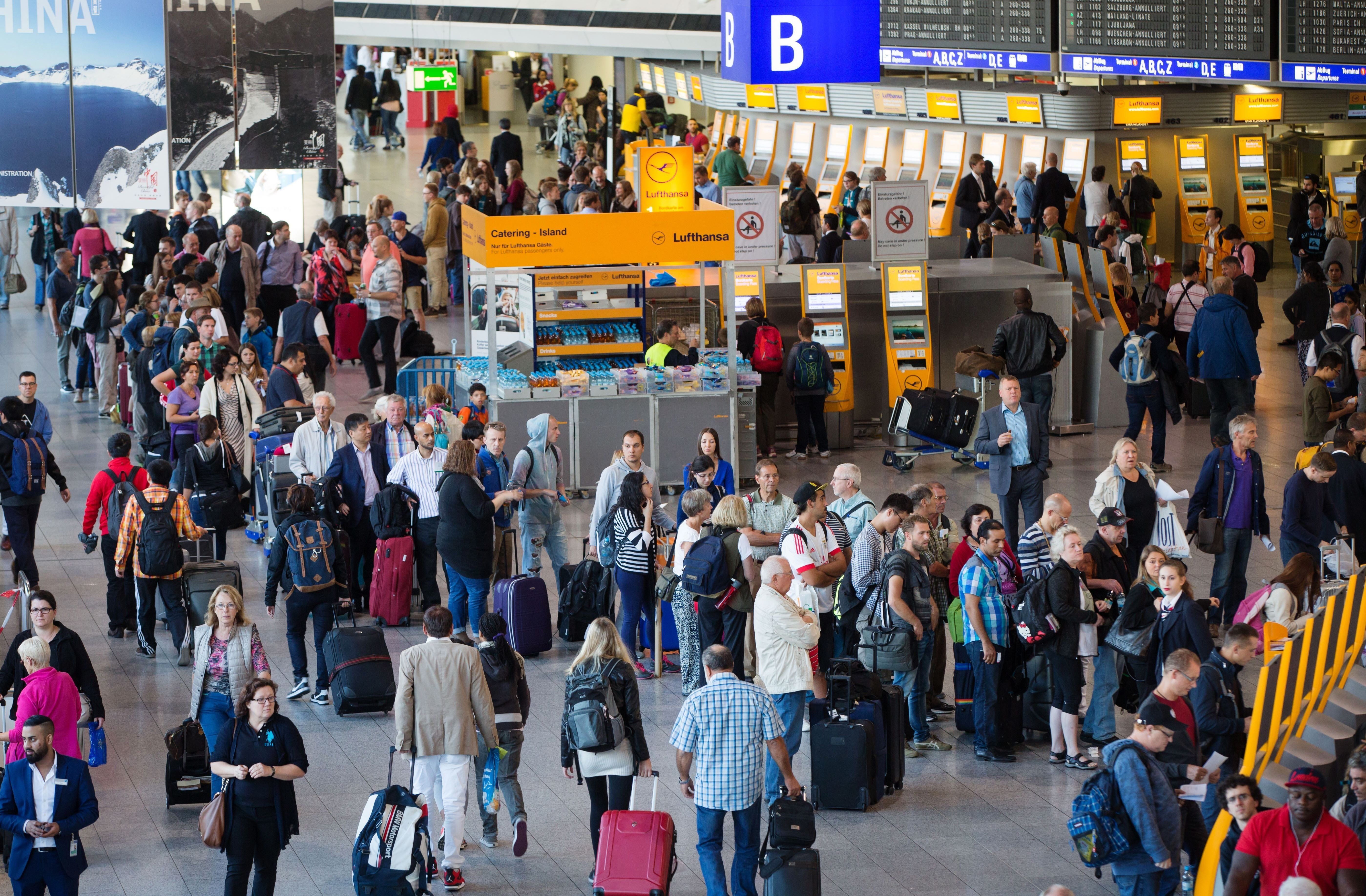Passengers wait at counters during a strike of pilots of German airline Lufthansa at the airport in Frankfurt am Main, western Germany, on September 9, 2015. German airline Lufthansa announced to cancel 1,000 short- and medium-term flights to and from Germany on September 9, 2015, on the second day of a two-day walkout by its pilots.  AFP PHOTO / DPA / FRANK RUMPENHORST +++ GERMANY OUT        (Photo credit should read FRANK RUMPENHORST/AFP/Getty Images)