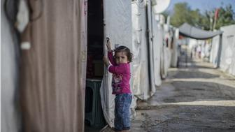 HATAY, TURKEY - OCTOBER 25:  A Syrian refugee girl, fled from her home due to civil war, is seen in Yayladagi YIBO camp in Hatay province of Turkey, on October 25, 2015. (Photo by Fatih Aktas/Anadolu Agency/Getty Images)