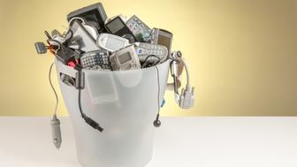 Electronic devices thrown in a dumpster