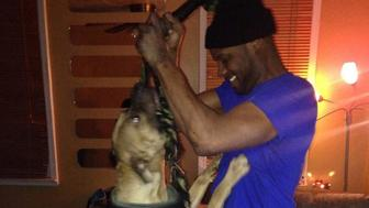 Carlyle Arnold, right, is seen with the pitbull that attacked and killed a 9-year-old girl.