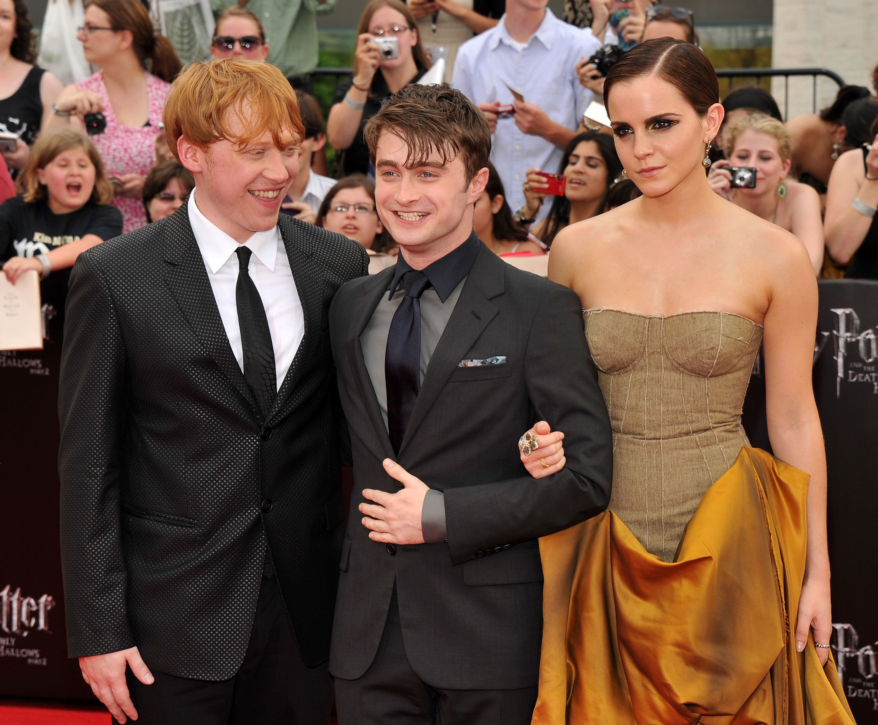 NEW YORK, NY - JULY 11:  (L-R) Rupert Grint, Daniel Radcliffe and Emma Watson attend the New York premiere of 'Harry Potter And The Deathly Hallows: Part 2' at Avery Fisher Hall, Lincoln Center on July 11, 2011 in New York City.  (Photo by Stephen Lovekin/Getty Images)