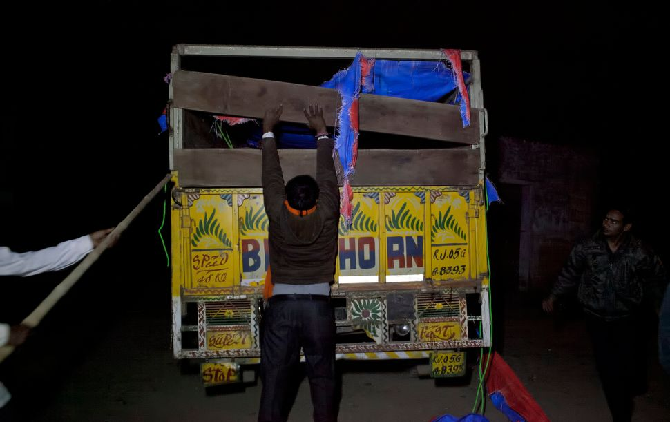 The Ramgarh vigilante group leader Nawal Kishore Sharma checks the bed of a truck that the group chased down.