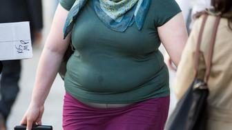 Embargoed to 2200 Monday November 9 File photo dated 23/04/15 of an obese woman in London as a spare tyre round the middle of an otherwise average-sized body is more dangerous than being fat all over, research has shown.