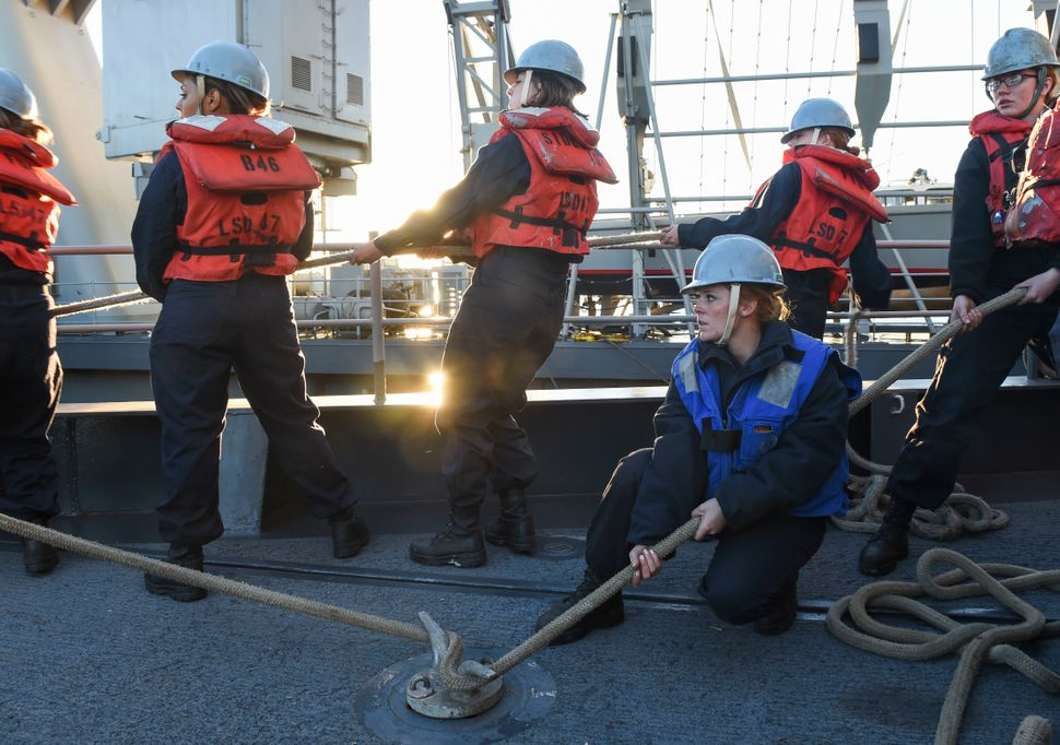 Sailors aboard the amphibious dock landing ship USS Rushmore (LSD 47) man lines to recover a safety boat on Jan. 23, 2015.