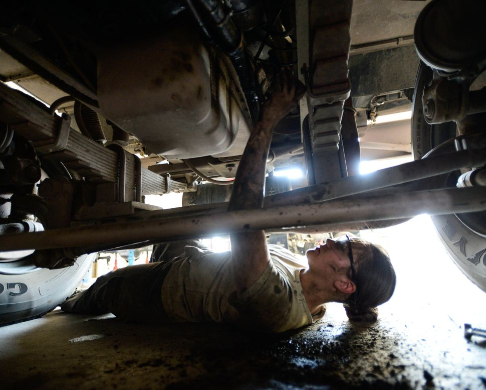 Staff Sgt. Saber Barrera, with 386th Expeditionary Logistics Readiness Squadron firetruck and refueling maintenance, works wi