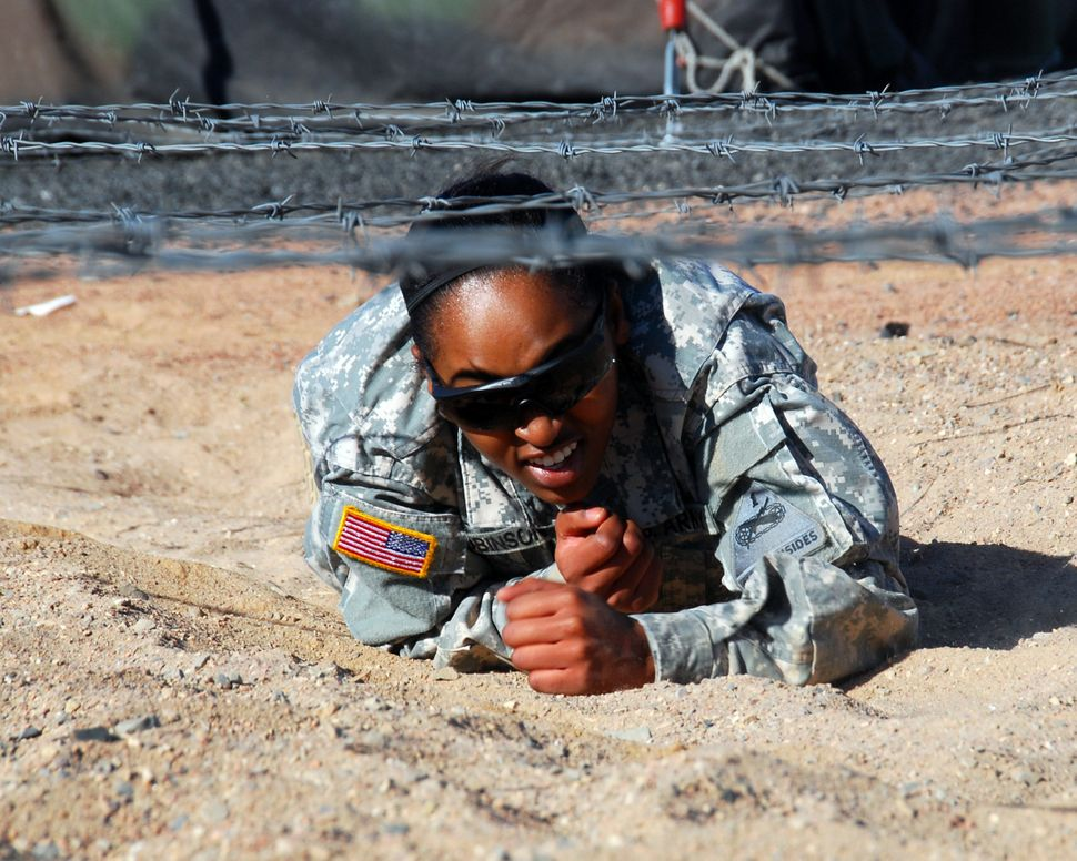 """The """"dead leg crawl"""" is one of nine obstacles on the Air Assault obstacle course at Fort Bliss, Texas. Pvt. Sonja"""