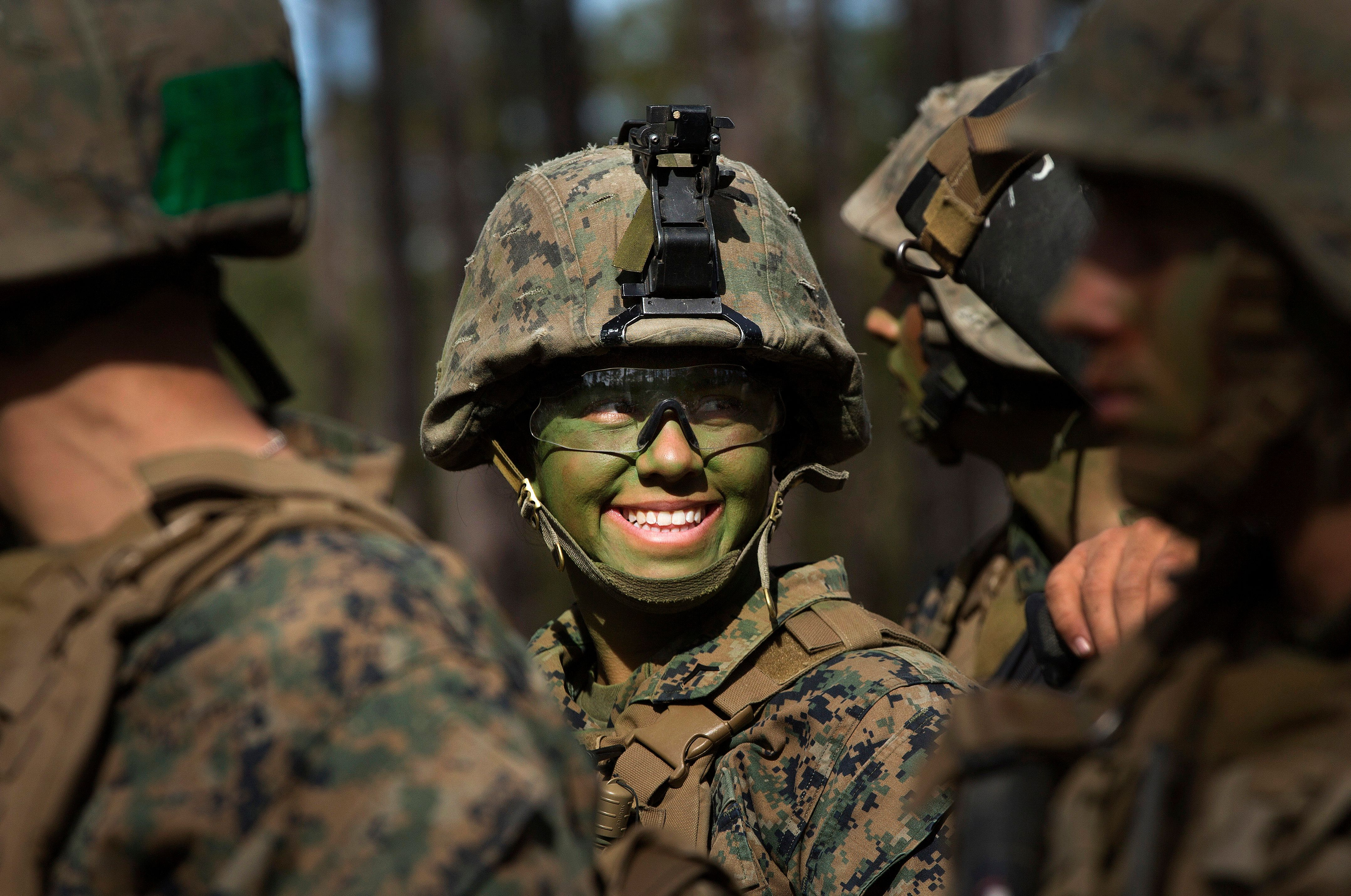Pfc. Christina Fuentes Montenegro and other Marines from Delta Company, Infantry Training Battalion , School of Infantry-East, receive final instructions prior to assaulting an objective during the Infantry Integrated Field Training Exercise aboard Camp Geiger, N.C., Nov 15, 2013. Montenegro is one of three female Marines to be the first women to graduate infantry training with the battalion. Delta Company is the first company at ITB with female students as part of a measured, deliberate and responsible collection of data on the performance of female Marines when executing existing infantry tasks and training events, the Marine Corps is soliciting entry-level female Marine volunteers to attend the eight week basic infantryman and infantry rifleman training courses at ITB.