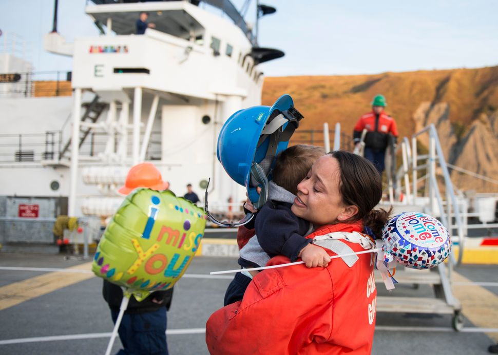 Chief Warrant Officer Heather Bove hugs her son, Gabriel, after returning to Kodiak, Alaska, from a patrol aboard Coast Guard