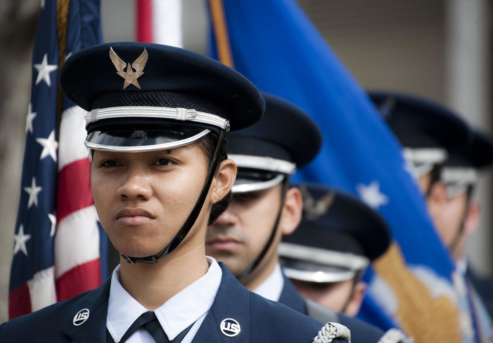 Senior Airman Hope Poialii leads the flag detail at an honor guard graduation ceremony on March 4, 2015, at Eglin Air Force B