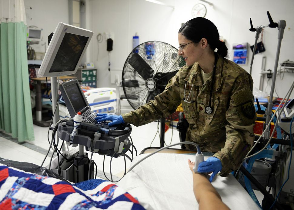 Maj. Anjeli Nayar, a 455th Expeditionary Medical Operations Squadron intensive care unit general internist, simulates patient